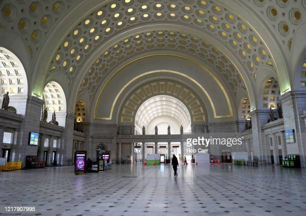 Woman walks through Union Station on April 09, 2020 in Washington, D.C. Amtrak and commuter trains have cut daily routes amid the coronavirus...