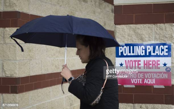 A woman walks to a polling station to cast his vote in Arlington Virginia on November 7 2017 In New Jersey and Virginia voters will elect a new...