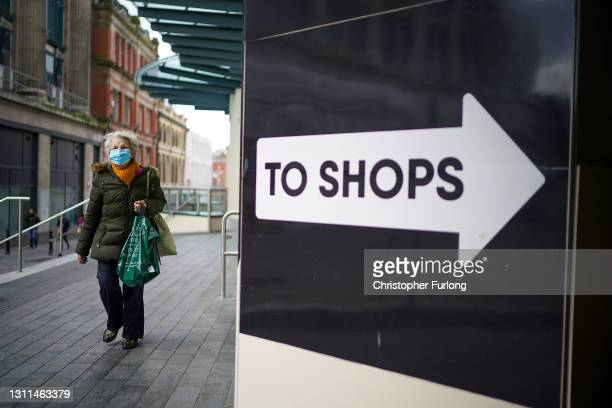 Woman walks to the shops in Liverpool city centre on April 08, 2021 in Liverpool, United Kingdom. All non-essential retail will be able to reopen...