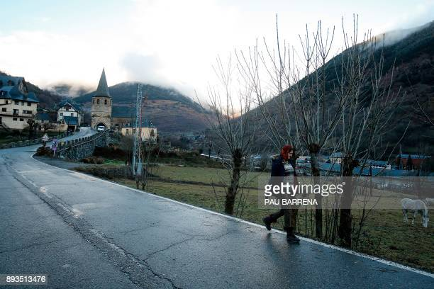 A woman walks to Vielha e Mijaran in the Aran Valley in northwest Catalonia on December 11 2017 Speaking a form of the Occitan language like some of...