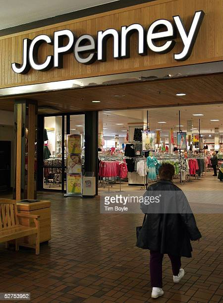 """Woman walks toward the entrance of a JCPenney store May 3, 2005 in Niles, Illinois. The magazine """"At Home with Chris Madden,"""" from Hachette..."""