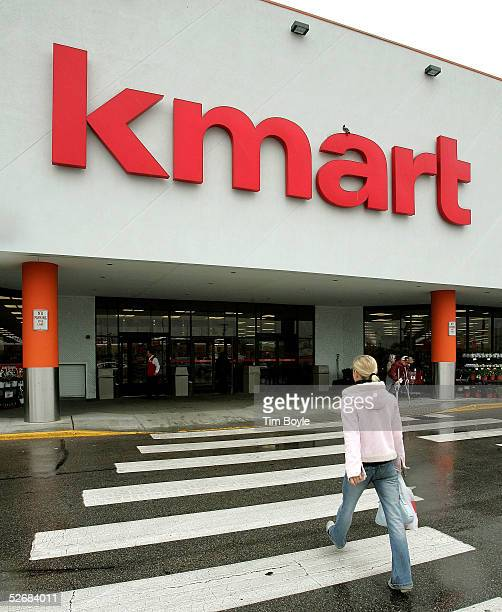 A woman walks towards a newly revamped Kmart store April 22 2005 in Norridge Illinois This particular store is one of nine 'test stores' where some...
