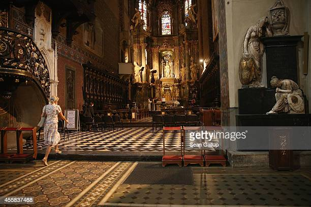Woman walks towards the mail altar in the Latin Cathedral on September 15, 2014 in Lviv, Ukraine. Lviv, which is located in western Ukraine near the...