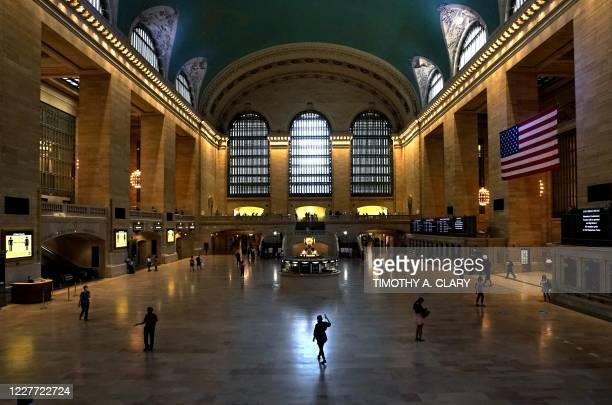 Woman walks with her cellphone in Grand Central Terminal, the historic world-famous landmark and transportation hub in Midtown Manhattan July 21,...