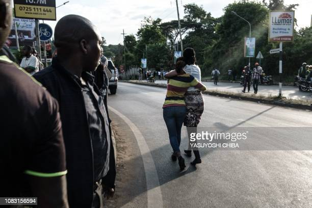 A woman walks with her sister after her evacuation from DusitD2 compound in Nairobi after a blast followed by a gun battle rocked the upmarket hotel...