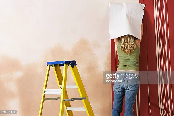 Woman Wallpapering