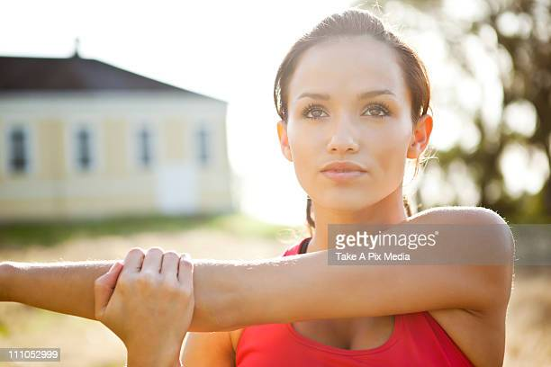 Woman warming up before exercise