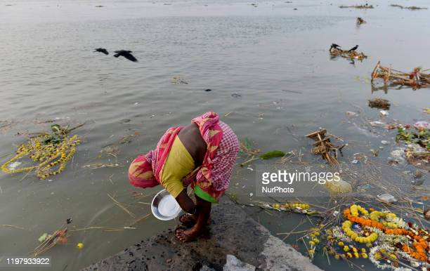 Woman washes a utensil on a polluted river Ganga in Kolkata, India, 01 February, 2020. Due to the over increase population and density, pollution in...