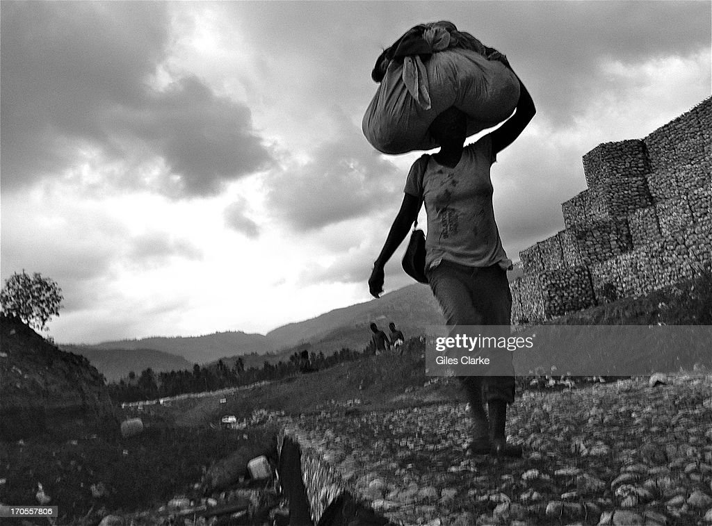 A woman washes her clothes in a river that runs down to the sea March 22, 2013 in Jacmel, Haiti. When Hurricane Sandy hit here a week before it hit New York City, many of the banana plantations that line the river were washed away.