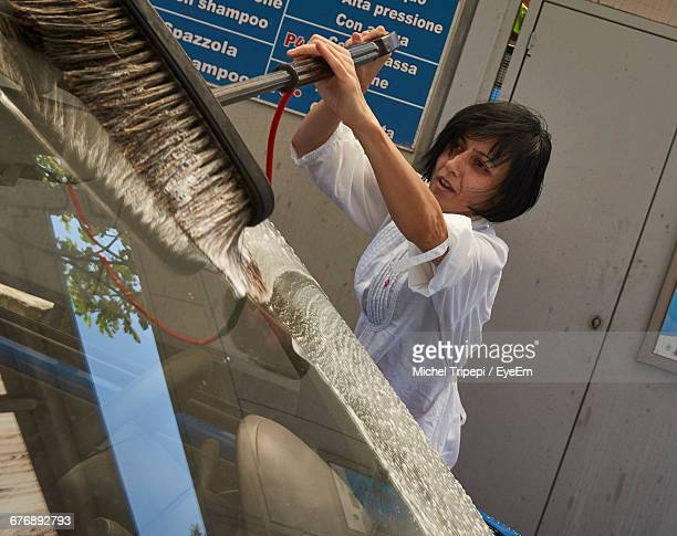 woman washing car - car wash brush stock photos and pictures