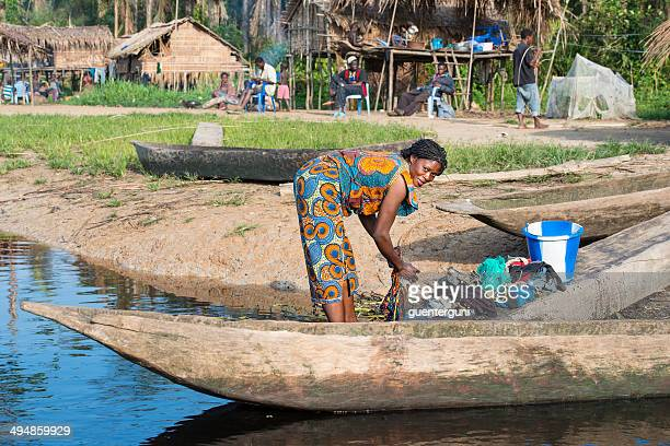Woman washing clothes in the Congo River
