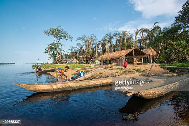 woman washing clothes in the congo river - democratic republic of the congo stock photos and pictures