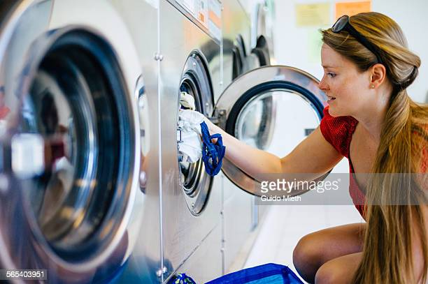 Woman washing clothes.