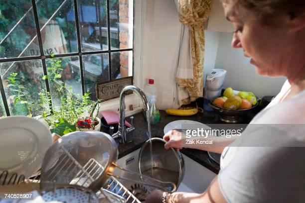 Woman washing dirty dishes