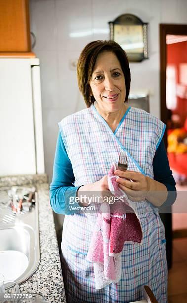 Woman washing dishes at home