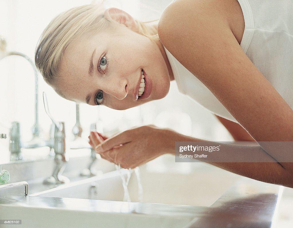 Woman Washing Face : Foto de stock