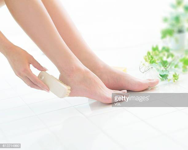 Woman washing feet