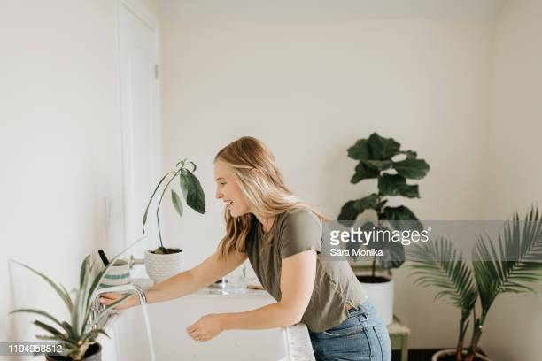 woman washing hands in sink - toilet planter stock pictures, royalty-free photos & images