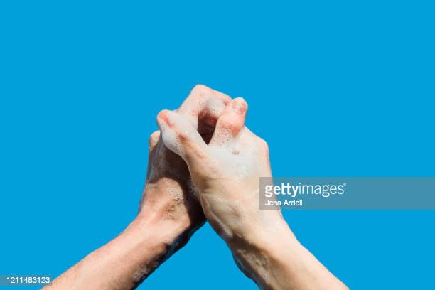 woman washing hands personal perspective, prayer hands, praying against coronavirus or covid19 - foam finger - fotografias e filmes do acervo