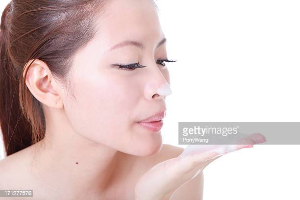 woman washing her beauty face with cleansing foam