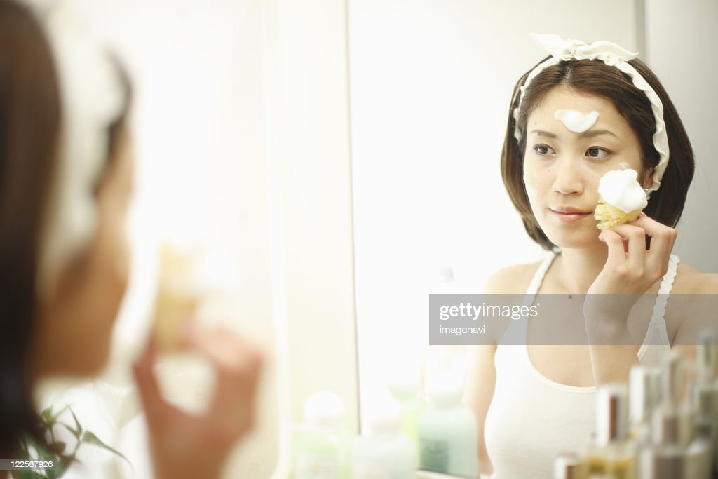 A woman washing her face : Stock Photo