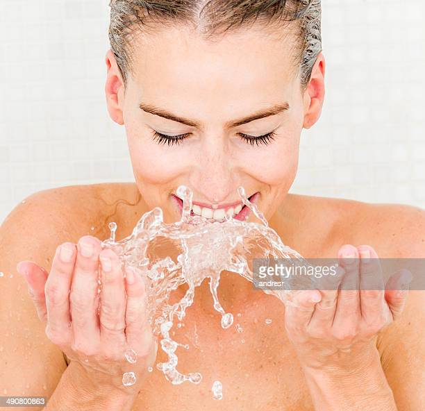 woman washing her face - human skin stock pictures, royalty-free photos & images