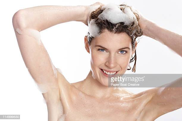 woman washing her hair with bubbly shampoo