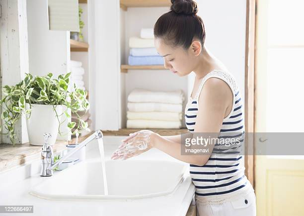 A woman washing her hands