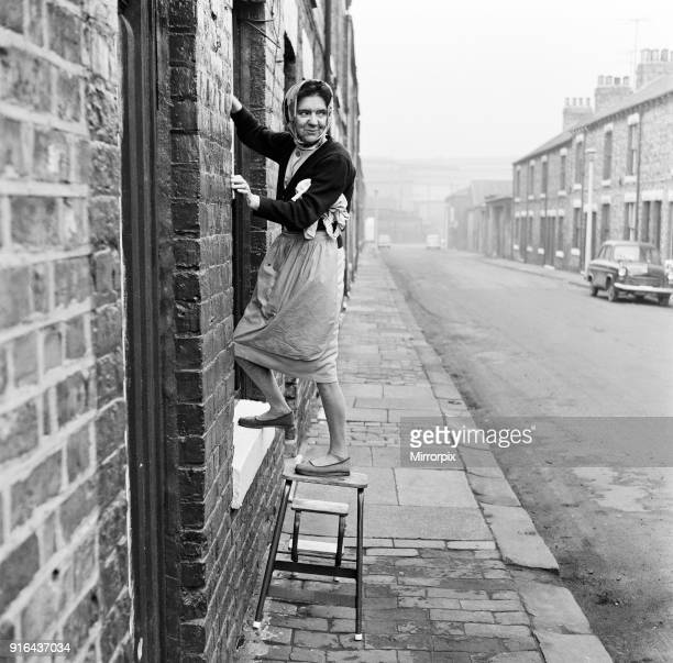 Woman washing her windows, Middlesbrough, North Yorkshire, 18th March 1968.