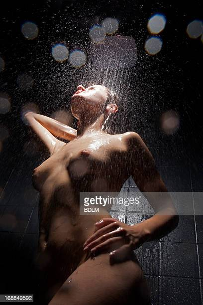 Woman washing herself in shower