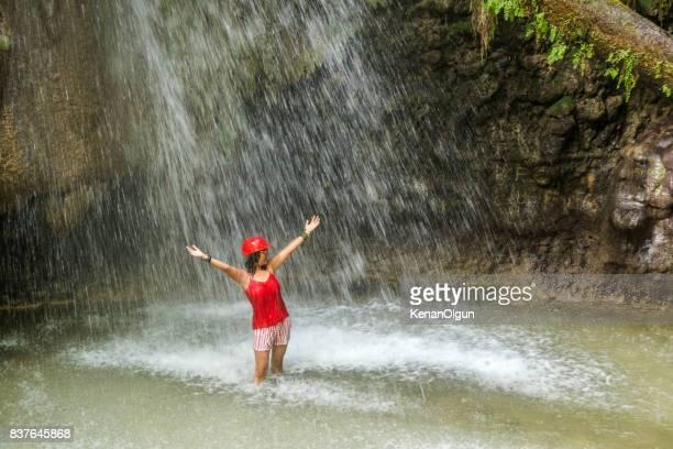 Woman washing in waterfall. Saklikent.