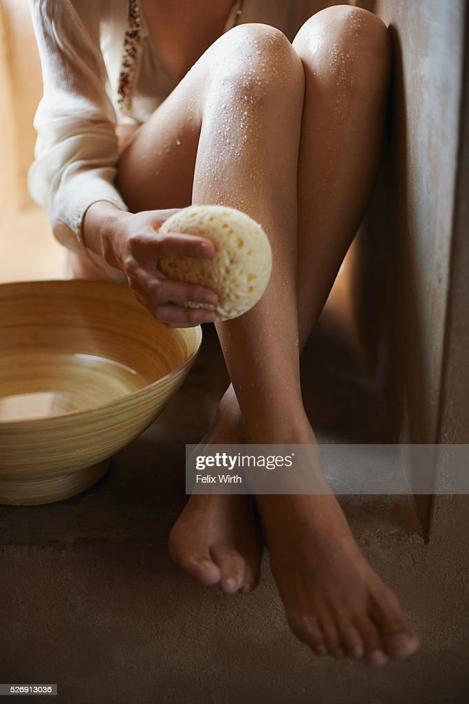 Woman washing legs : Stock Photo