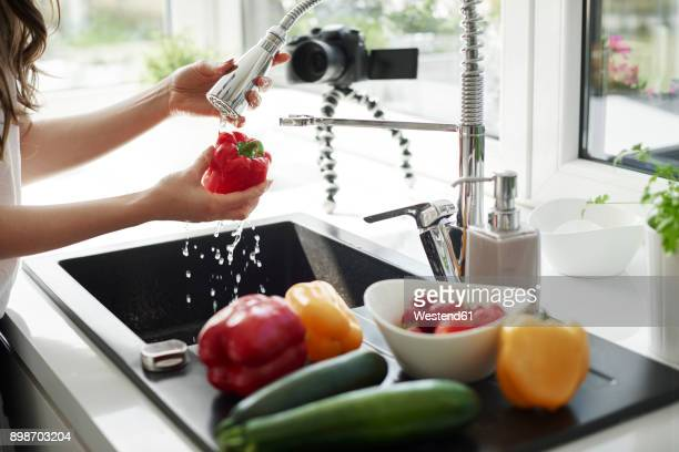 woman washing vegetables at kitchen sink - 水周り ストックフォトと画像