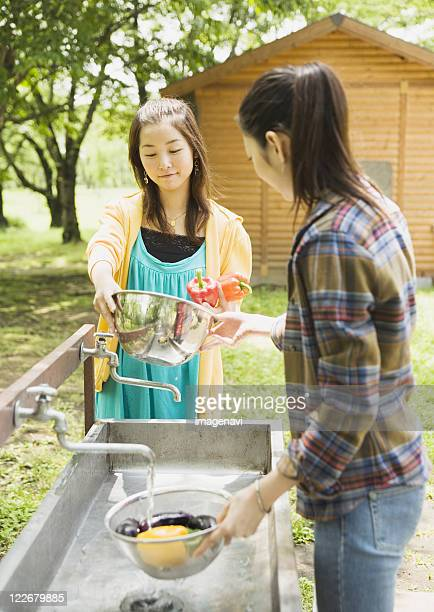 Woman washing vegetables