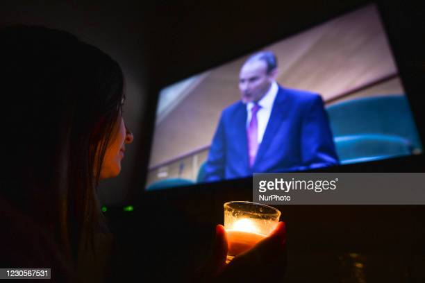 Woman watches a televised address by Taoiseach Micheal Martin delivering a landmark apology to survivors of mother and baby homes. The Mother and...