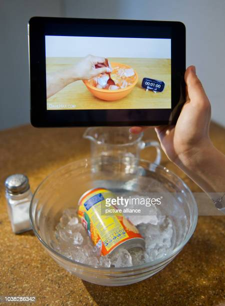 A woman watches a video tutorial on a tablet computer in Hanover Germany 15 September 2014 'Life hacking' is a trend with bloggers giving daily life...