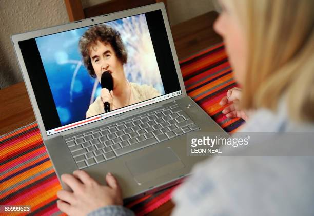 A woman watches a YouTube clip of Scottish charity worker Susan Boyle's appearance on television programme 'Britain's Got Talent' in London on April...