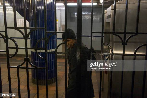 A woman watches as a friend boards the subway on a nearby platform March 4 2018 in Brooklyn New York The New York subway system faces a deteriorating...