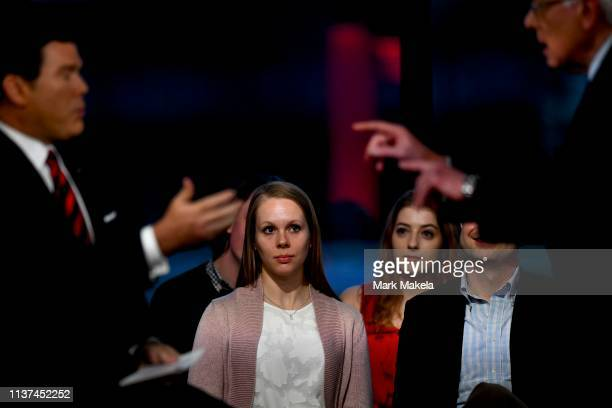 Woman watches as Democratic presidential candidate, U.S. Sen. Bernie Sanders answer a question by news anchor Bret Baier in a FOX News Town Hall at...