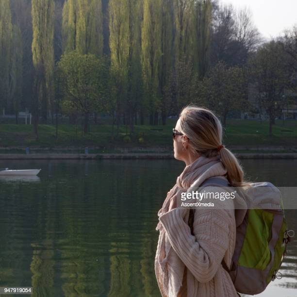 woman watches canoe paddle upriver, turin, piedmont, italy - wonderlust stock pictures, royalty-free photos & images