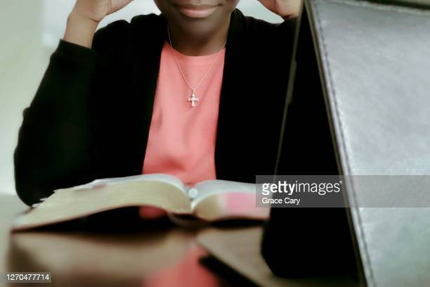 woman watches online church service - necklace stock pictures, royalty-free photos & images