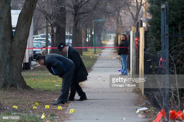 A woman watches police investigate the scene of a shooting that happened in the 5200 block of West Ferdinand Street on Saturday Dec 23 2017 in the...