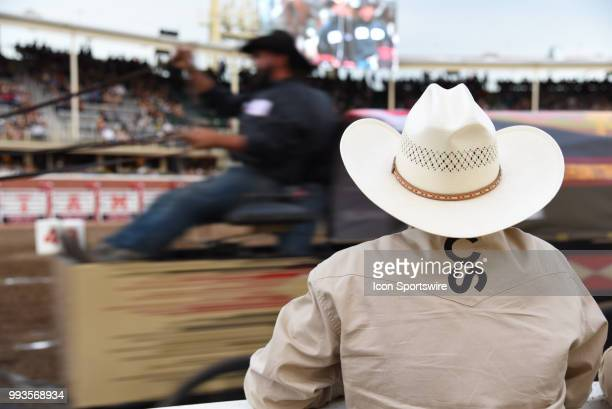 A woman watches the GMC Rangeland Derby Chuckwagon Races at the Calgary Stampede on July 6 2018 at Stampede Park in Calgary AB