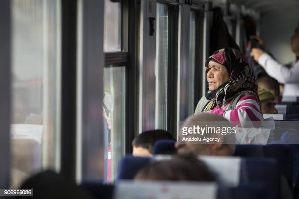 A woman watches the landscape as she travels with the Eastern Express which travels from Ankara to Kars in Ankara Turkey on January 13 2018 With the...