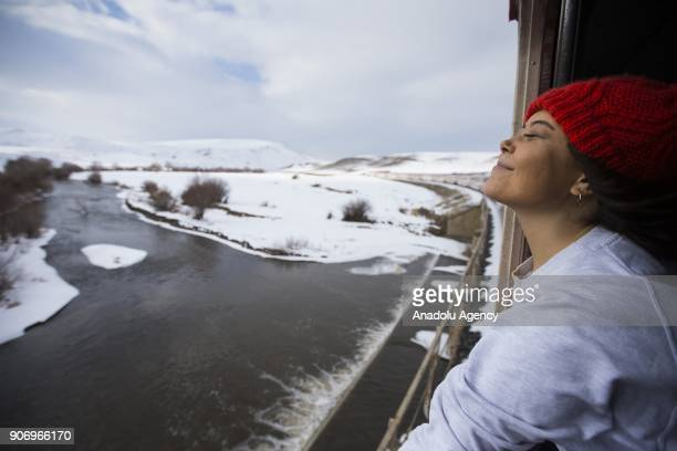 A woman watches the landscape as she travels with the Eastern Express which travels from Ankara to Kars in Kars Turkey on January 13 2018 With the...