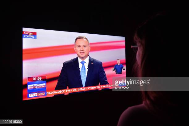 Woman watches the official televised presidential debate organised in the town of Konskie and broadcasted on TVP1, Poland's public broadcaster...