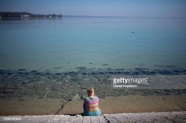 Woman watches the scene at Lake Constance on April 06, 2020 in Konstanz, Germany. The number of confirmed coronavirus cases in Germany has surpassed...