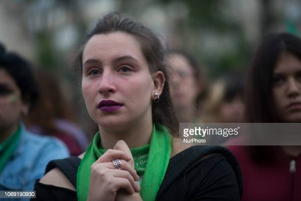 A woman watches the speech of the Lucía Perez' mother a 16yearold girl killed by two men accused of sexually abusing her and who finally they were...