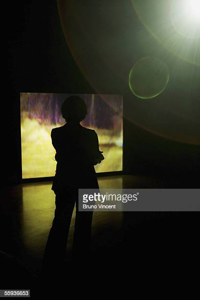 A woman watches Turner Prize shortlist artist Darren Almond's video installation at the Tate Britain gallery on October 17 2005 in London The...