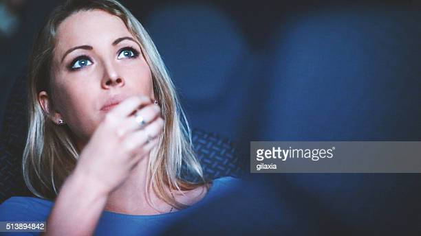 woman watching a movie at movie theater. - movie photos stock pictures, royalty-free photos & images